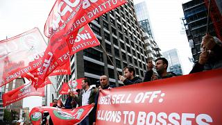 Private hire drivers protest outside the offices of Uber in London