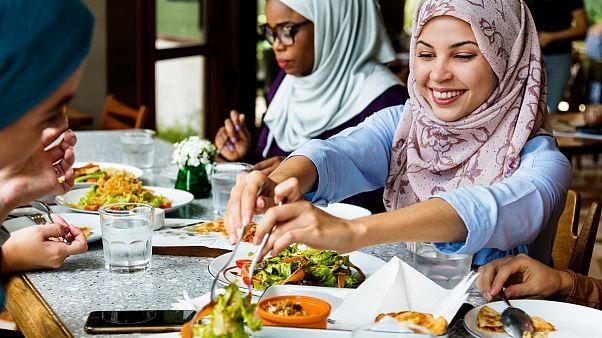 Muslim family eating dinner