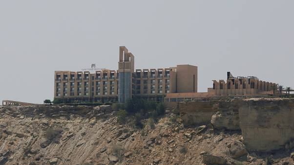 Security forces kill three gunmen who stormed a luxury hotel in Pakistan's Baluchistan province