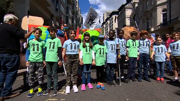 Children lead climate change marches across Europe