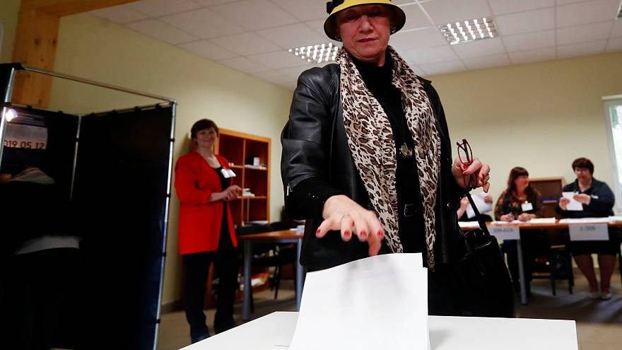 A woman casts her vote in Vilnius, Lithuania on May 12, 2019.