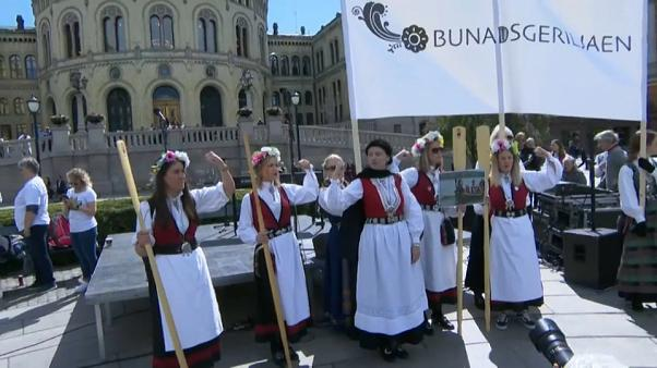 Several women dressed in the bunad (national costume)