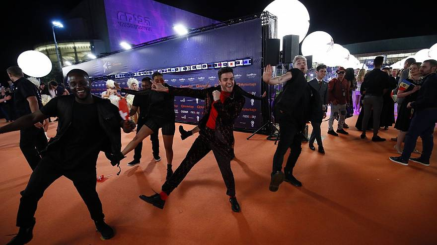 Luca Hänni of Switzerland shows off his dance moves on the Orange Carpet