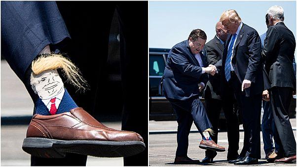"""شاهد: حاكم لويزيانا يستقبل ترامب بجوارب """"ترامب"""""""