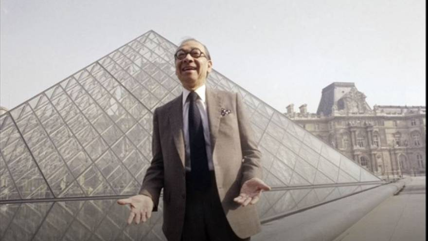 Architect I.M. Pei stands in front of the Louvre