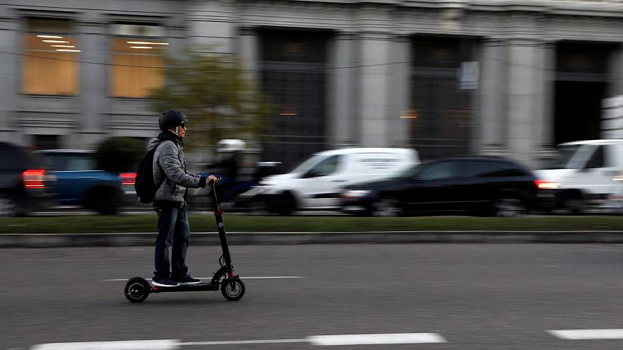 A man rides an electric scooter in Madrid, Spain, December 4, 2018.