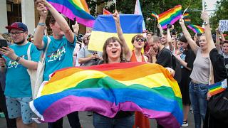 LGBT activists cheer at a solidarity march in Chisinau, Moldova