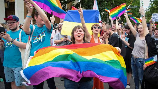 LGBT activists cheer at a solidarity march in Chisinau, Moldova
