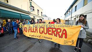 Workers on strike prevent a Saudi ship from loading cargo in Genoa