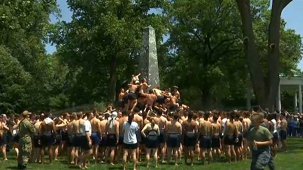 U.S. Naval Academy first-years attempt annual greased climb