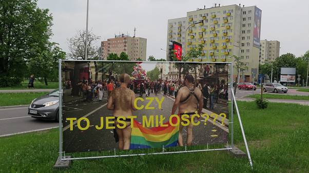 A banner which reads 'Is this love?' is pictured in Swidnik, Poland
