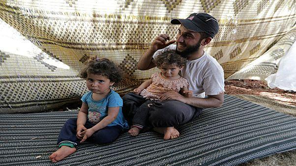السوري علي الأحمد وأطفاله