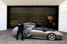 Police officers uncover a Lamborghini Murcielago 2007, to be auctioned.