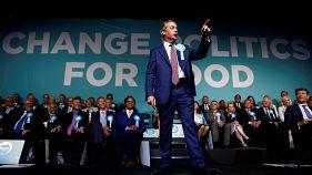 Brexit Party leader Nigel Farage gestures as he speaks in London on 21 May.