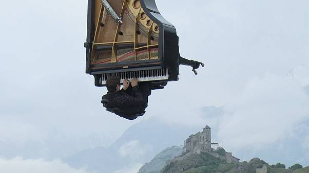 Hitting the high notes: Hanging from a crane, a pianist plays in the air