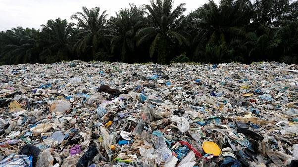 Plastic waste is piled outside an illegal recycling factory in Malaysia