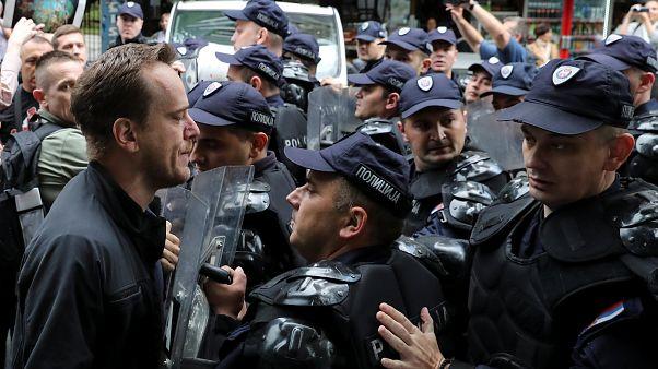 Serb protestors scuffle with riot police in Belgrade