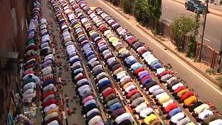 Muslim prayers spill over into street on the last Friday of Ramadan