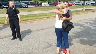 Survivors and witnesses embrace after the Virginia Beach shooting