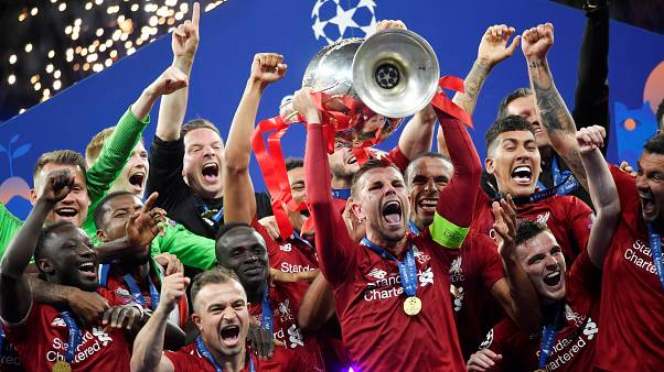Liverpool lift their sixth Champions League trophy, defeating Tottenham 2-0 in Madrid
