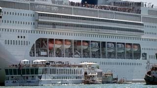 At least 5 injured after giant cruise ship hits tour boat and dock in Venice