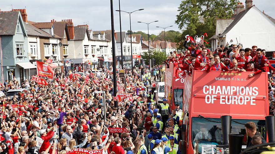 Liverpool's team bus travels past fans during the parade