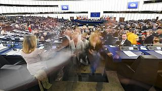 MEPs exit Plenary chamber after voting session.