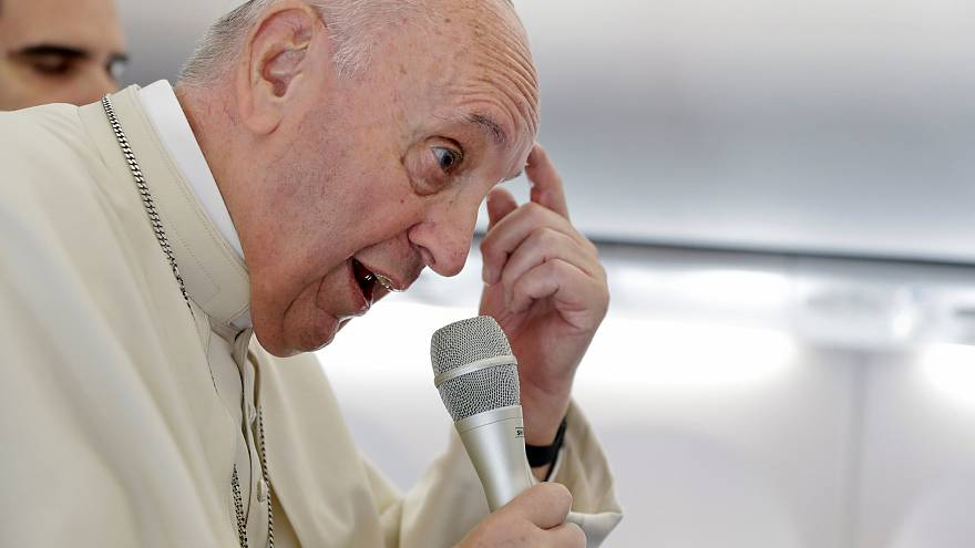 Pope Francis answers questions on the papal plane after visit to Romania