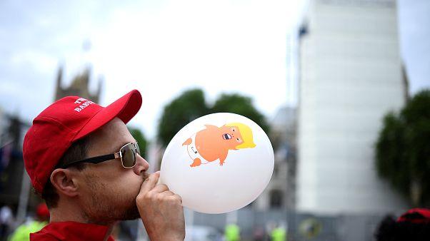 Trump baby blimp flies above London as thousands protest leader's visit