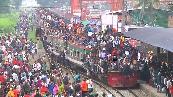 Thousands cram themselves on to trains hoping to make it home for Eid