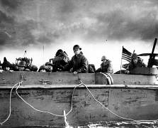 U.S. Army troops and crewmen aboard a Coast Guard manned LCVP approach