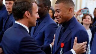 Watch: Macron gives prestigious Legion of Honour order to French football team