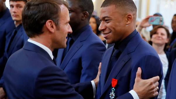 Watch: Macron gives prestigious Legion of Honour order to French football team