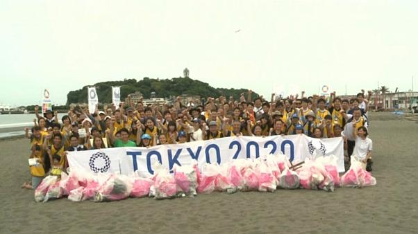 Teams compete to pick up trash on Tokyo 2020 Olympic beach