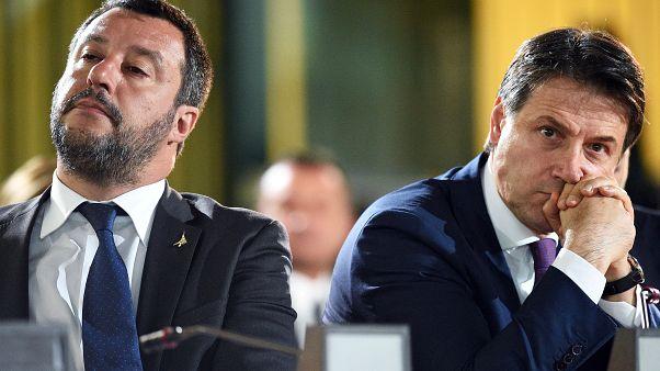 Matteo Salvini and Giuseppe Conte (l-r) face massive fines