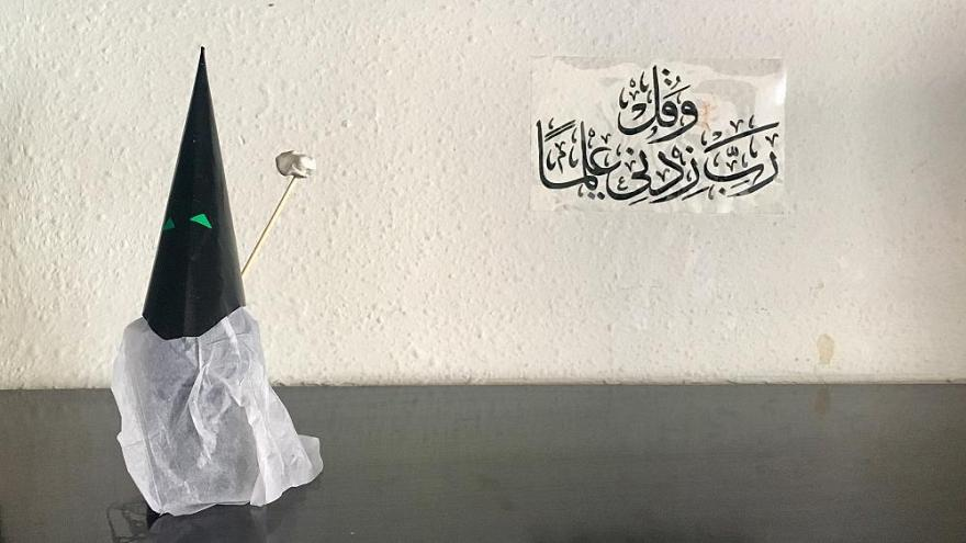Capirote of Holy Week made with paper and a Koranic inscription