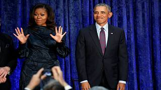 الرئيس الأمريكي السابق باراك أوباما وزوجته ميشال خلال حفل في واشنطن اليوم