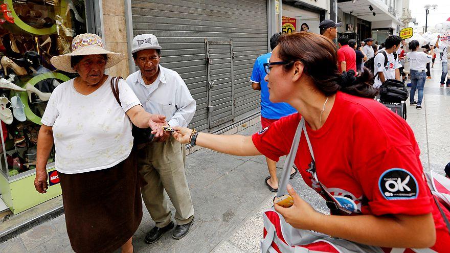 An international aid worker hands out condoms