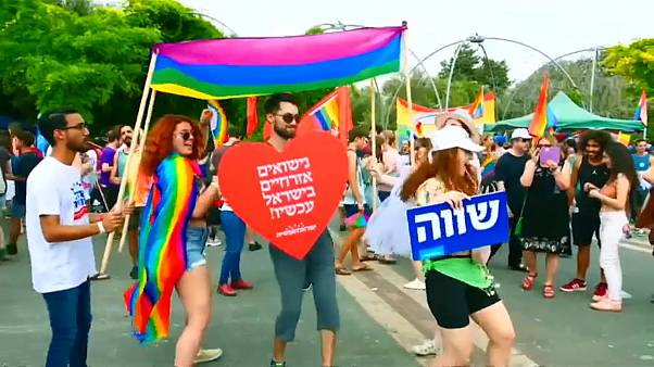 Watch: Gay pride march takes place amid tensions in Jerusalem