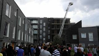 Fire breaks out at London flats as 100 firefighters deal with emergency