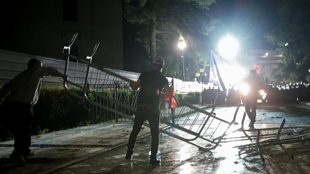 Opposition supporters dismantle barricades outside Parliament building