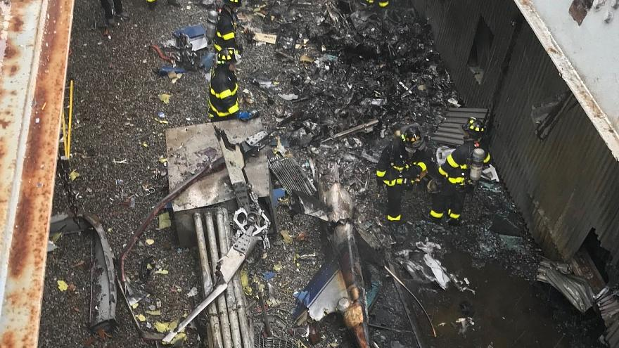 One dead as helicopter crashes into building in midtown Manhattan