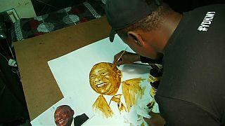 رئيس أفريقيا الجنوبية سيريل رامافوسا مرسوماً بالقهوة