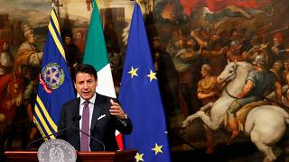 Italian Prime Minister Giuseppe Conte gestures as he holds a news conference at Chigi Palace in Rome
