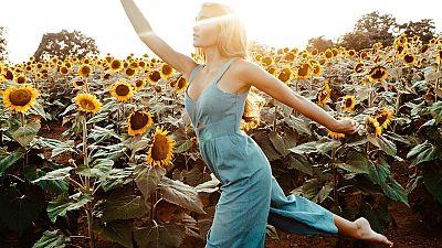Woman in a jumpsuit, sunflower field