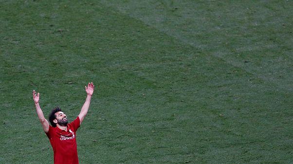 صلاح يحتفل بإحراز لقب دوري أبطال أوروبا مع ليفربول (صورة من الأرشيف)