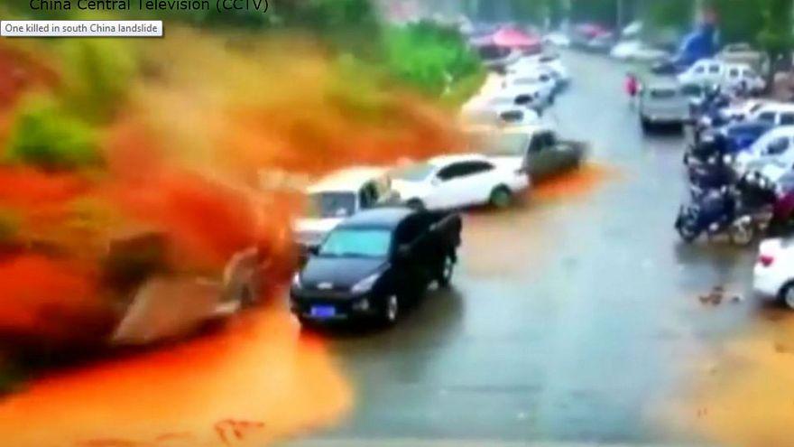 Huge landslide kills one man and buries several cars