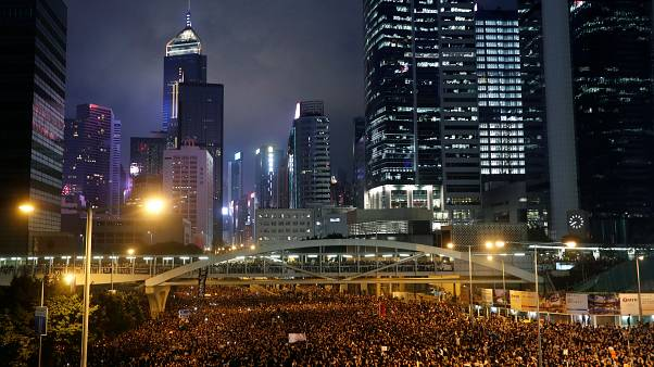 Protesters attend a demonstration demanding Hong Kong's leaders to step down