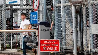 """Former student leader Joshua Wong walks out from prison after being jailed for his role in the Occupy Central movement, also known as """"Umbrella Movement"""""""