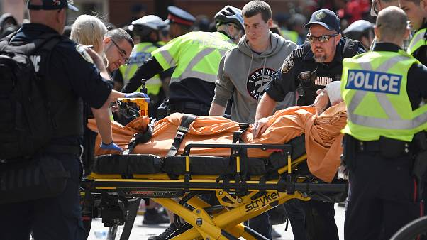 A woman is taken away by ambulance after reports of shots fired in Toronto, Canada June 17, 2019.